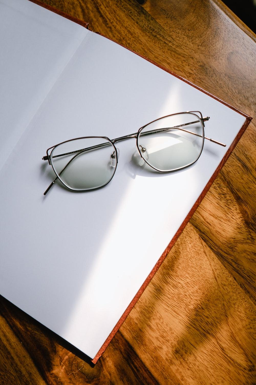 black framed eyeglasses on white table