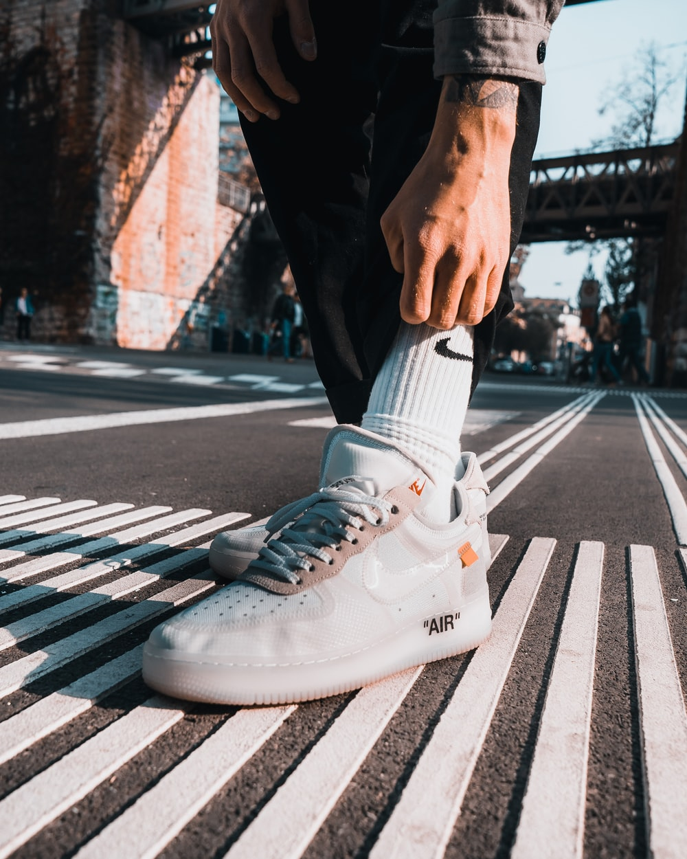 person wearing white nike air force 1 high