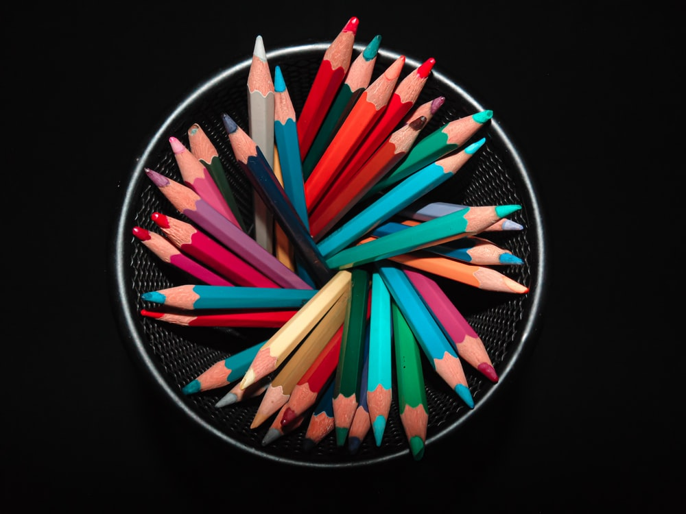 coloring pencils on black round container