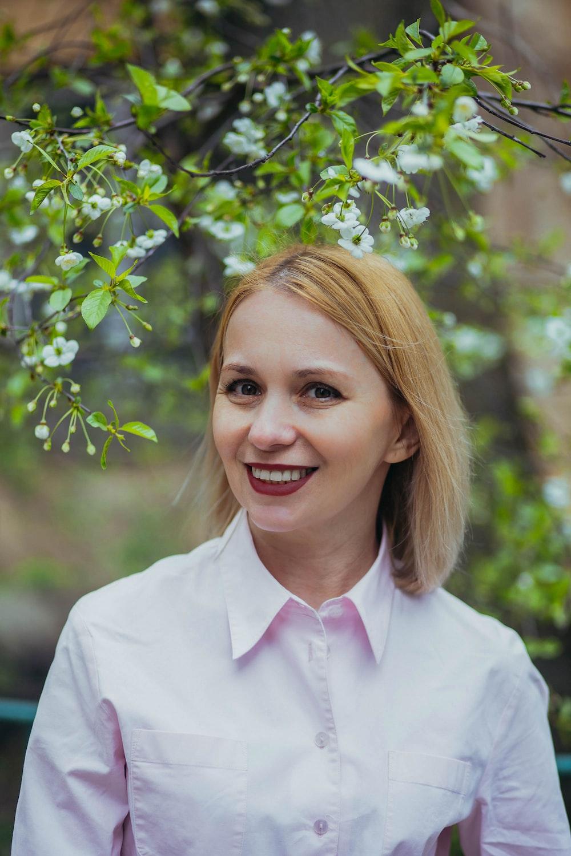 smiling woman in white dress shirt