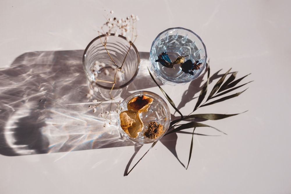 clear glass bowl with brown liquid