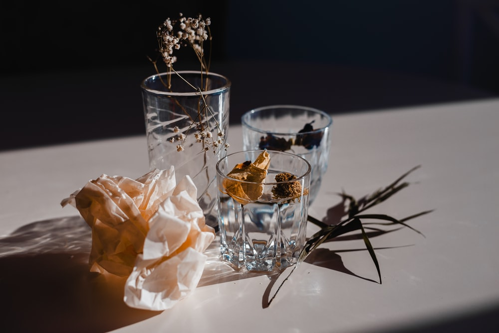 clear drinking glass with ice cubes