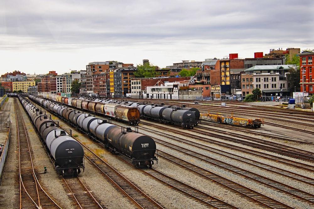 black train on rail road during daytime