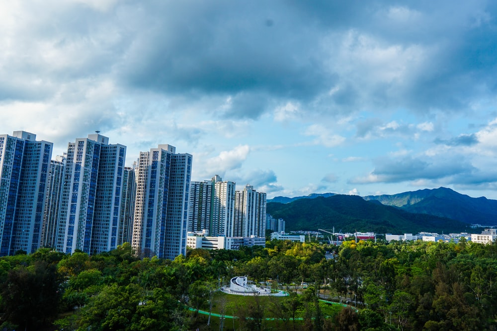 high rise buildings under gray clouds during daytime