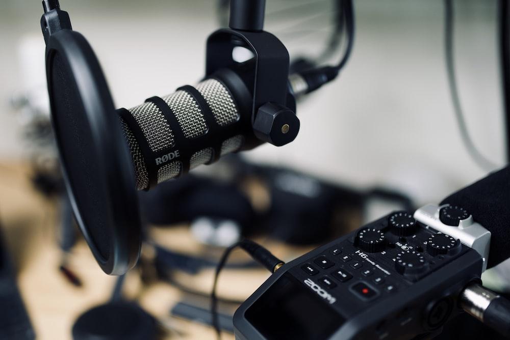 black and gray headphones on black audio mixer