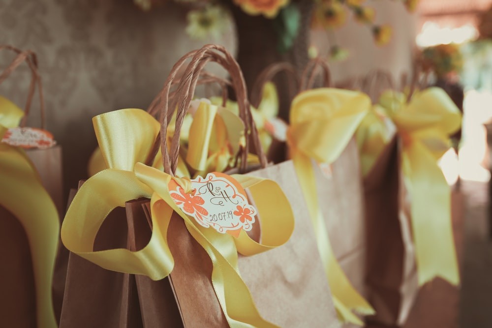 yellow and white ribbon on brown wooden rack