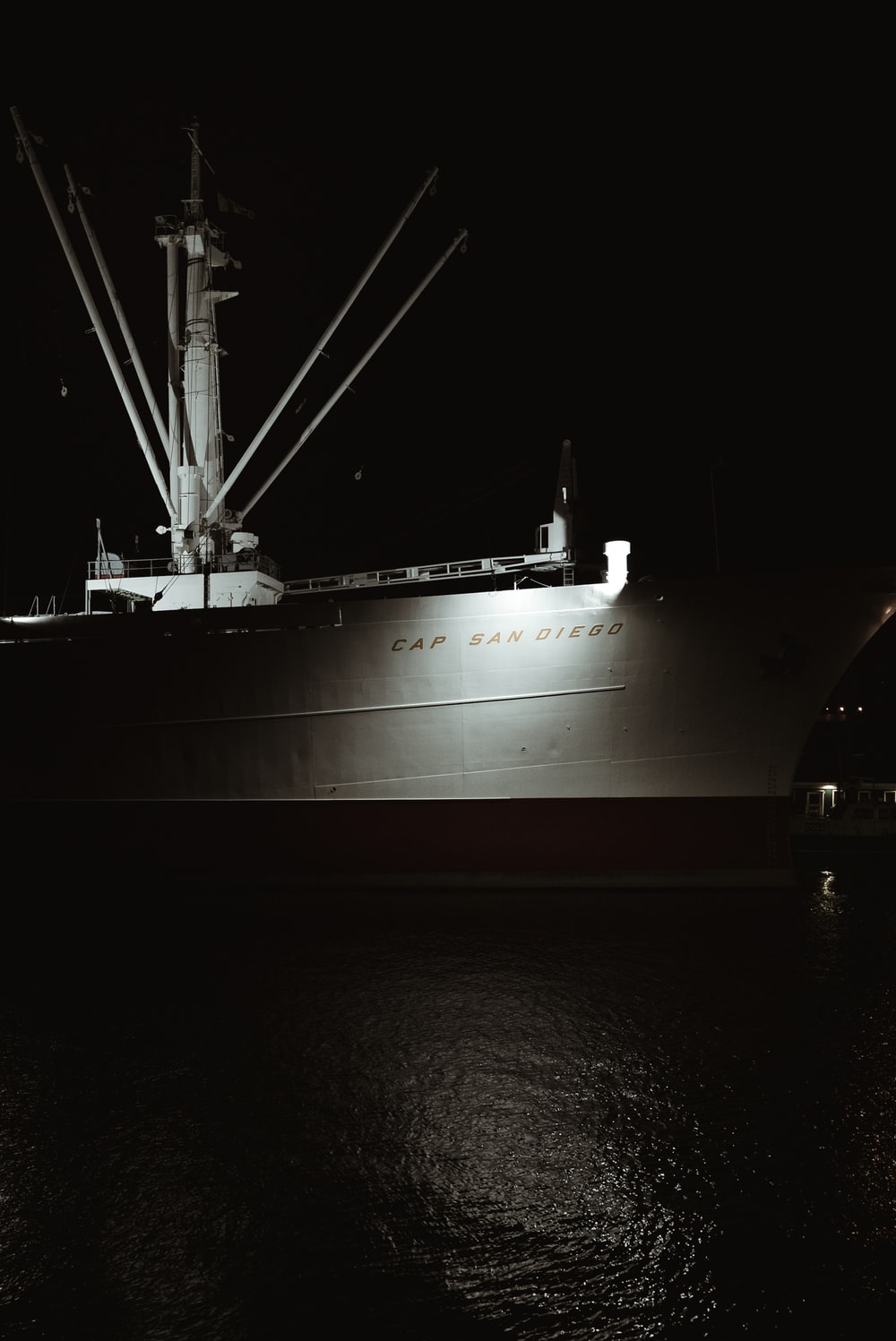 white ship on body of water during night time