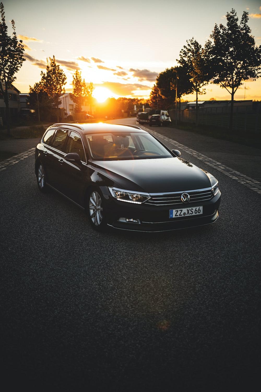 black mercedes benz sedan on road during sunset