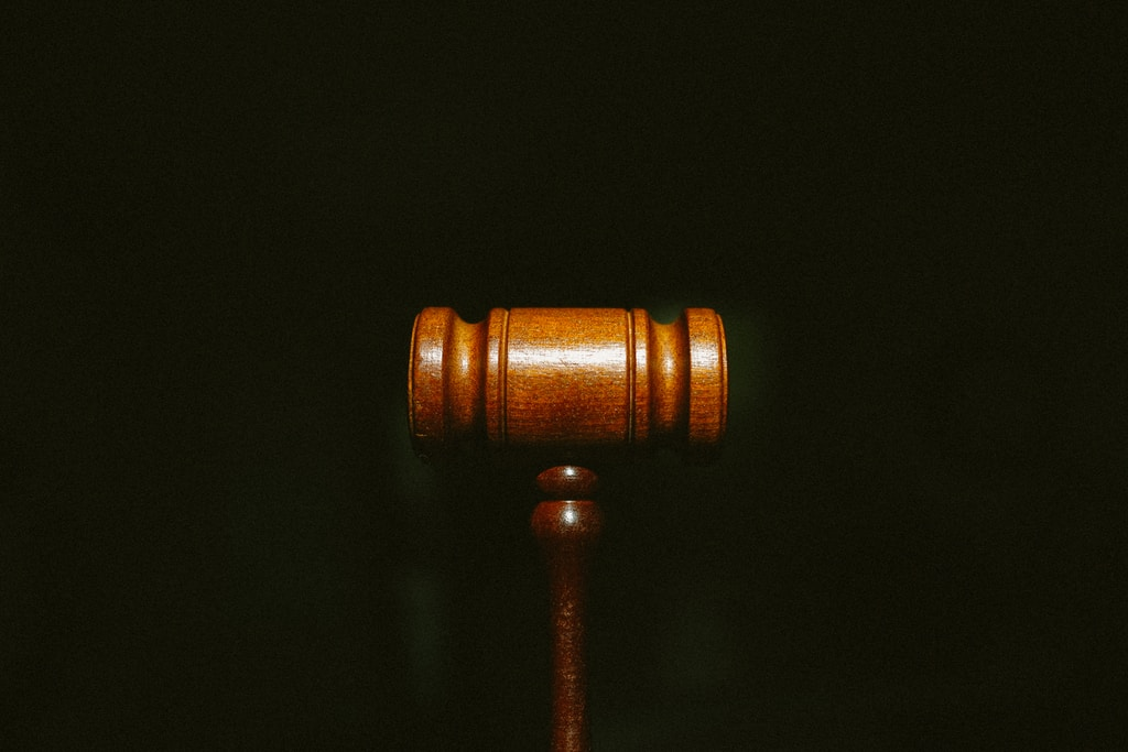 brown wooden stand with black background