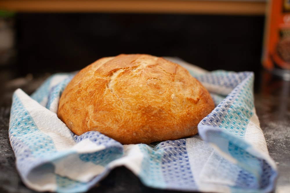 bread on white and blue textile