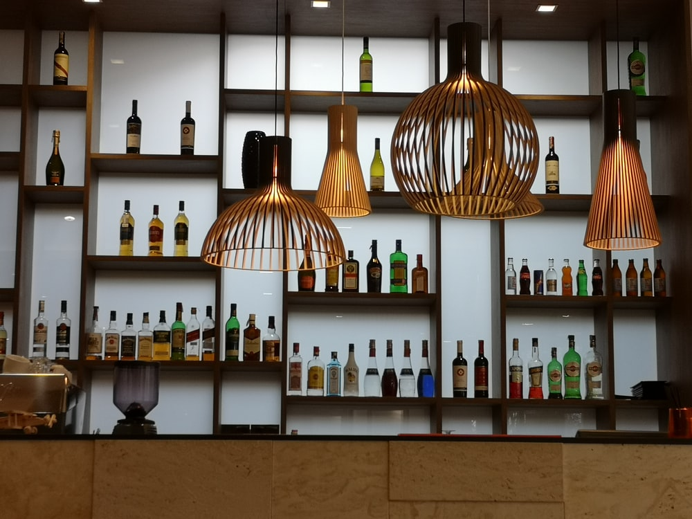 brown pendant lamps turned on in room