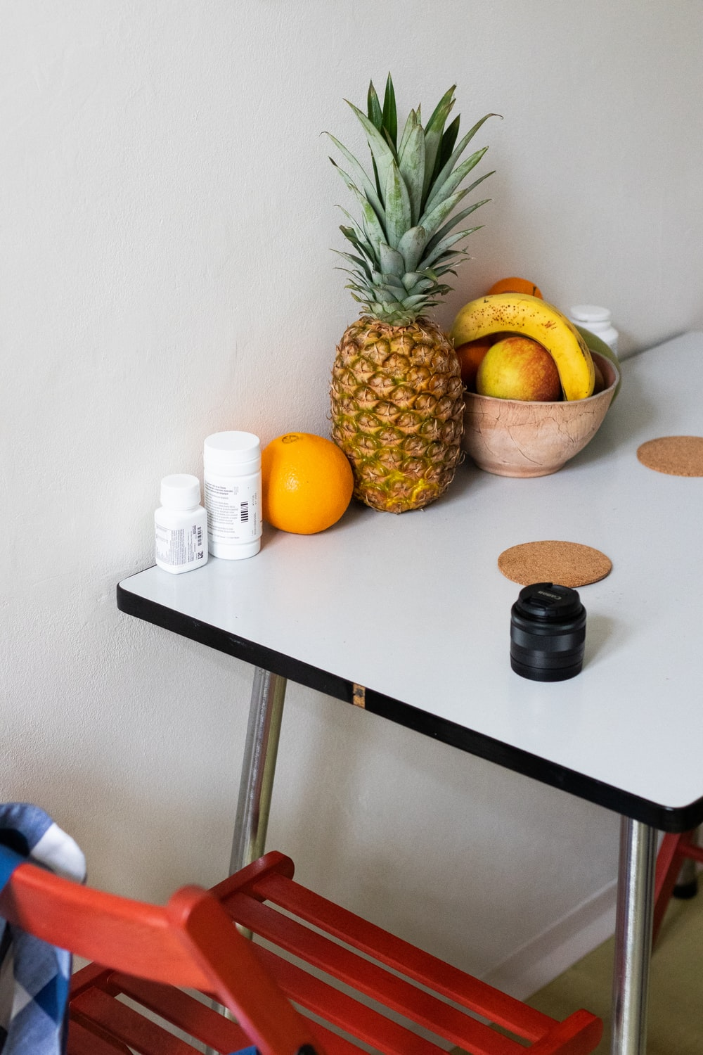 yellow and green pineapple fruit on black wooden table