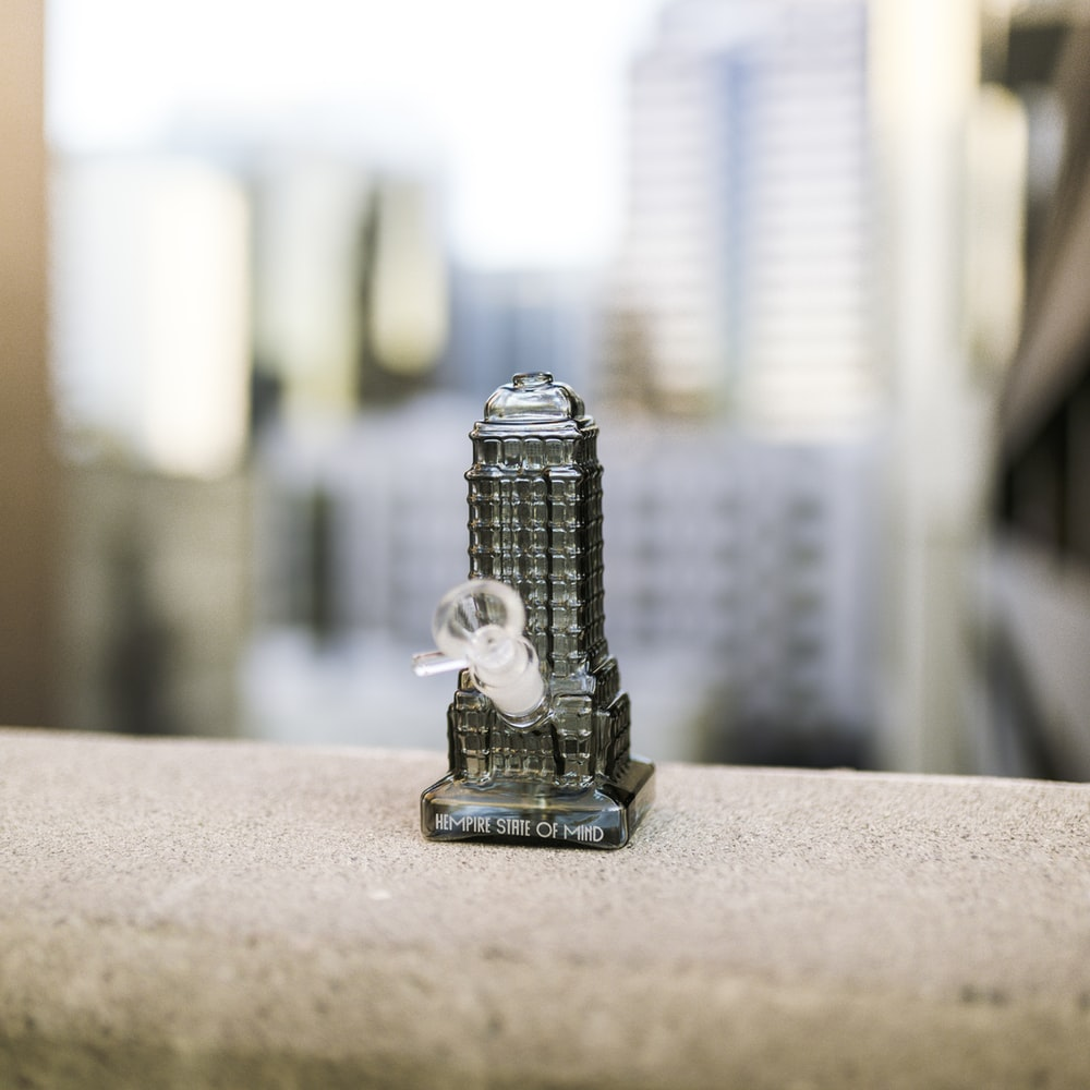 silver lego toy on brown table