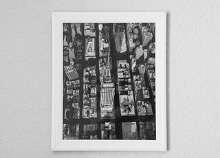grayscale photo of people in picture frame