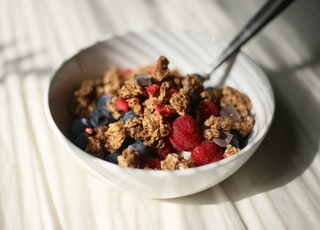 brown cereals in white ceramic bowl