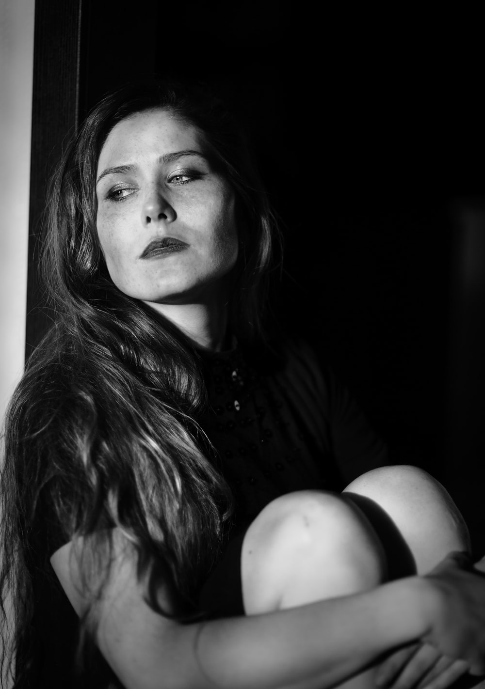 woman in black shirt in grayscale photography