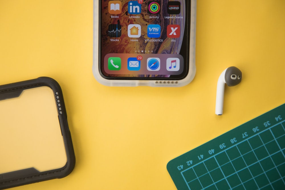 silver iphone 6 on yellow table
