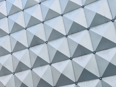 white and gray concrete building triangle zoom background