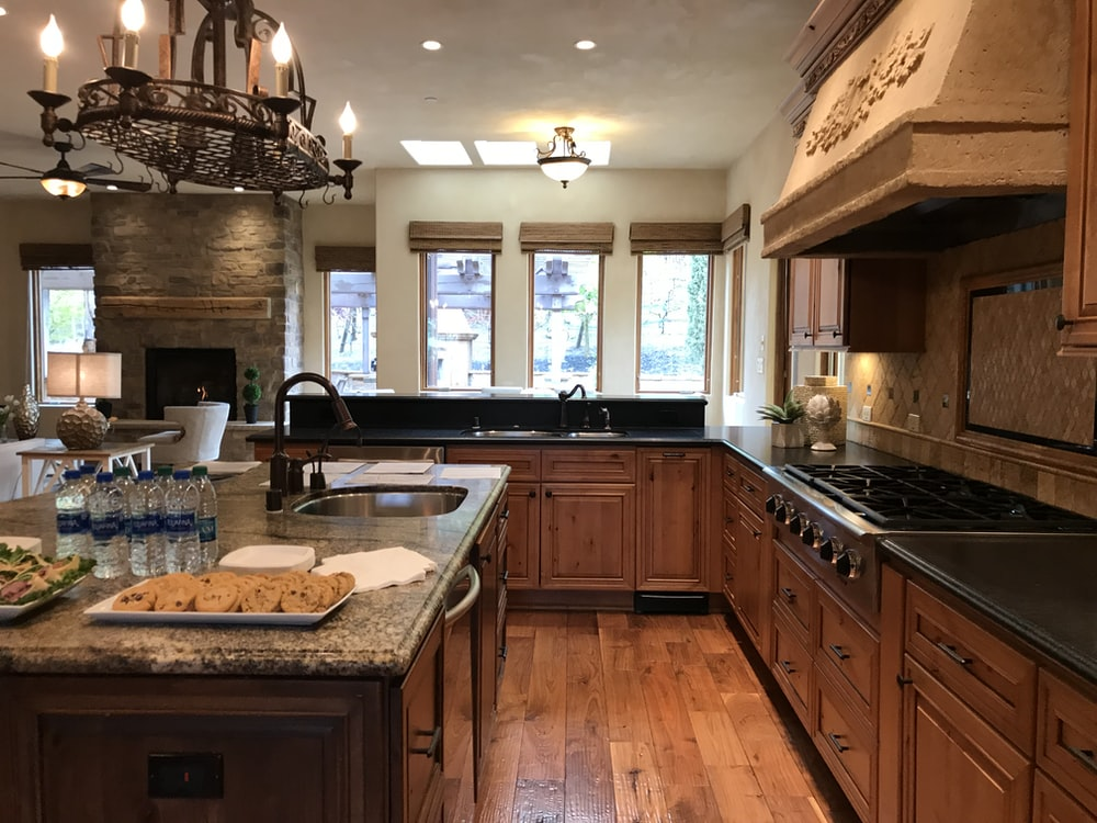brown wooden kitchen cabinet with sink