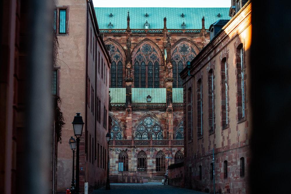 brown brick building with green metal window