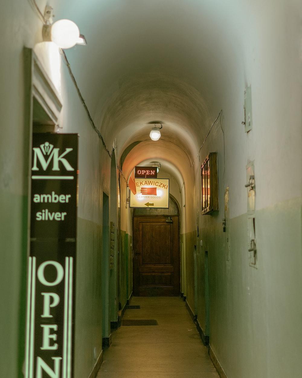 hallway with green metal doors