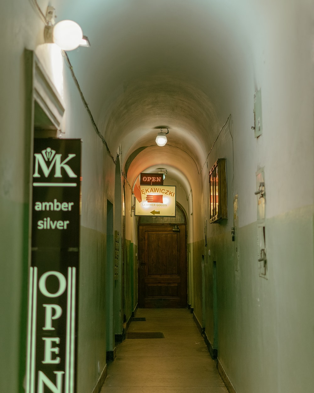 hallway with green metal doors