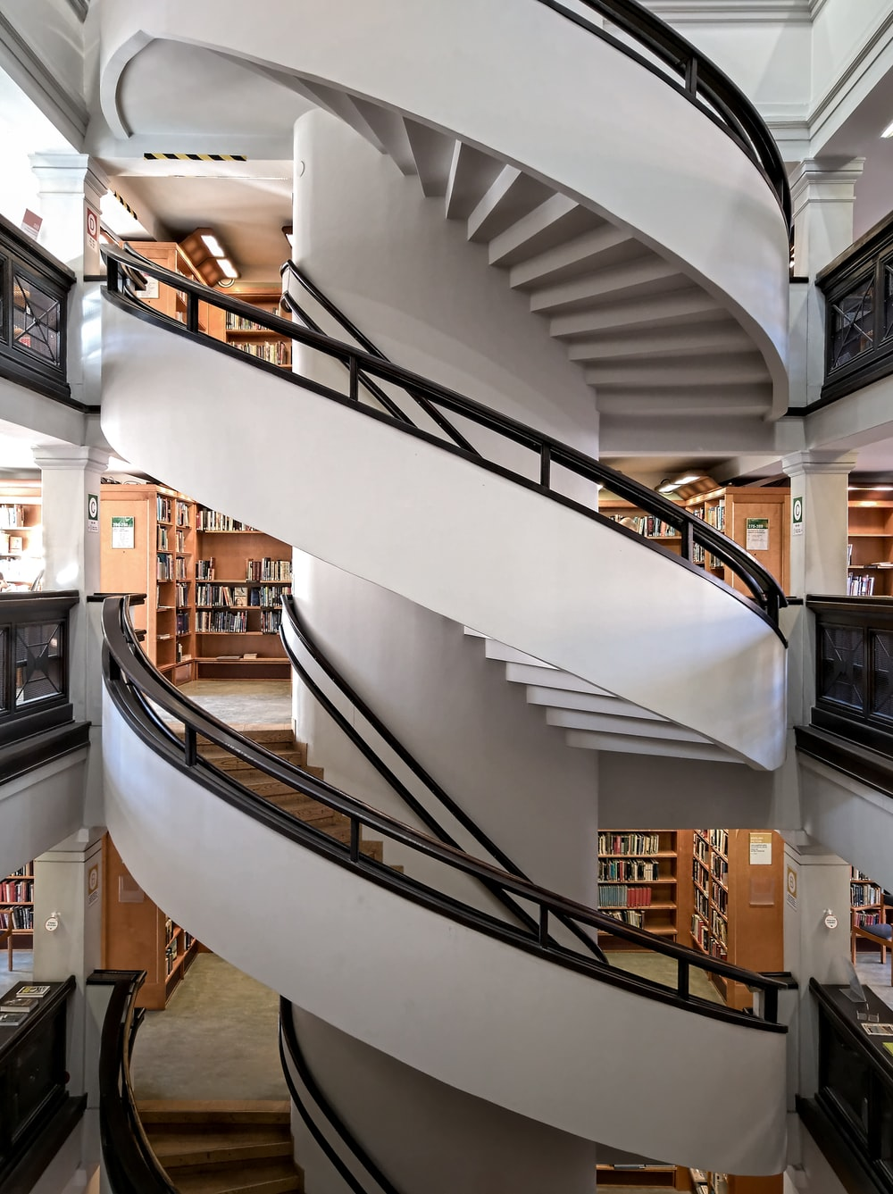 white and brown spiral staircase