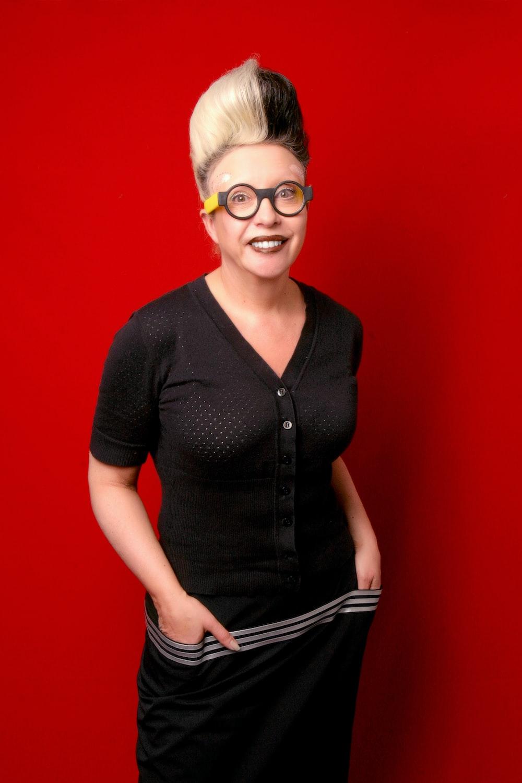 woman in black button up shirt wearing black framed eyeglasses