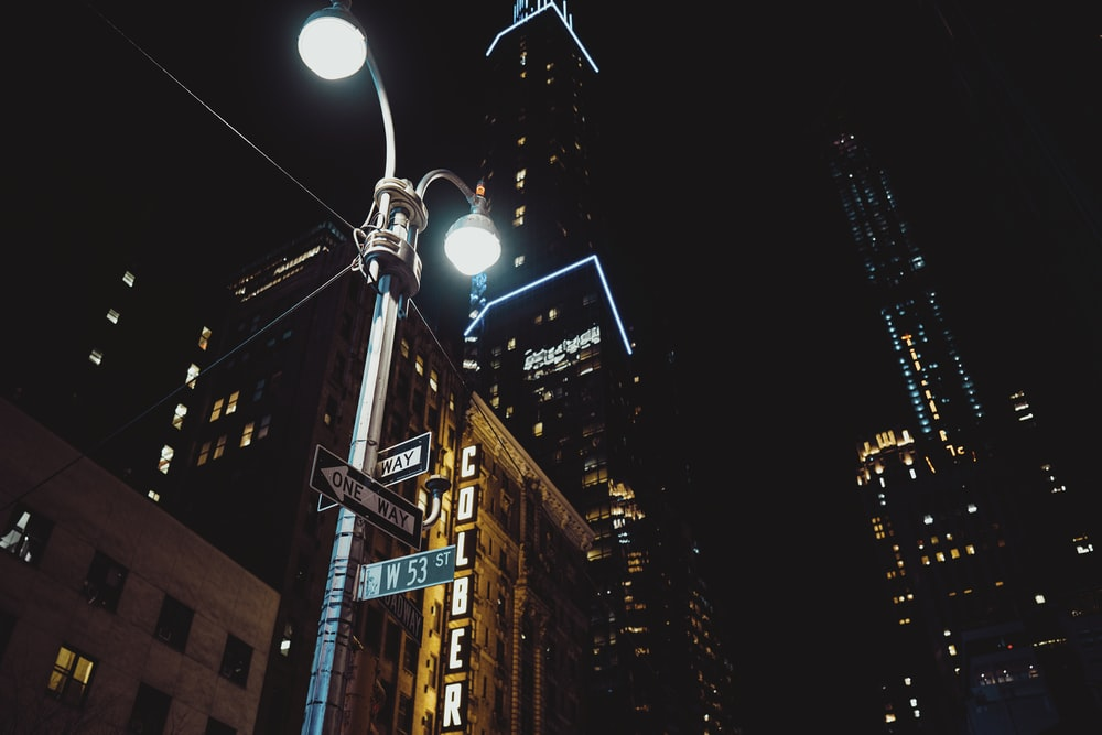 street light near high rise buildings during night time