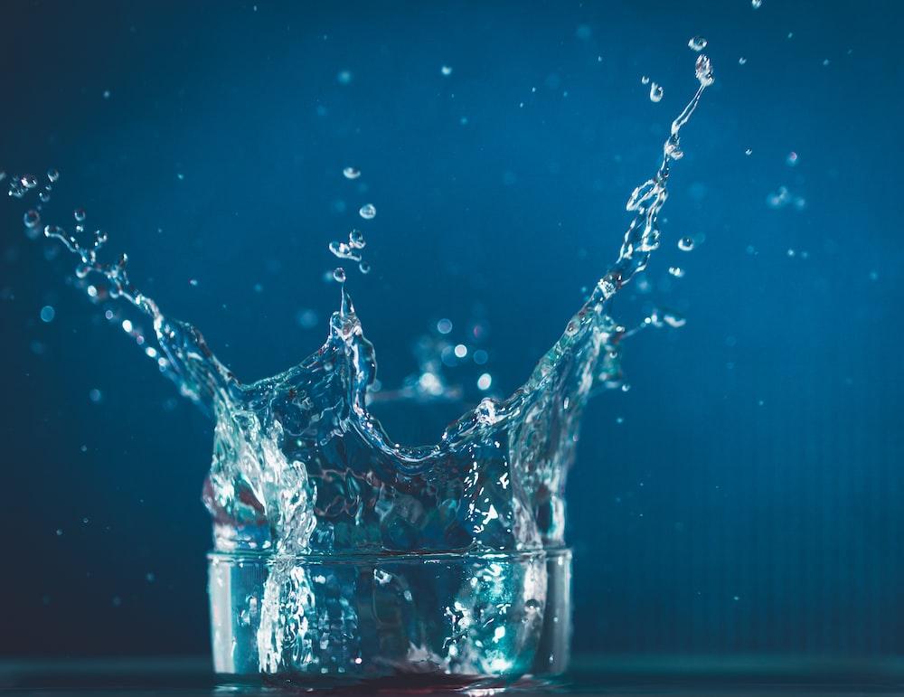 water splash in clear drinking glass