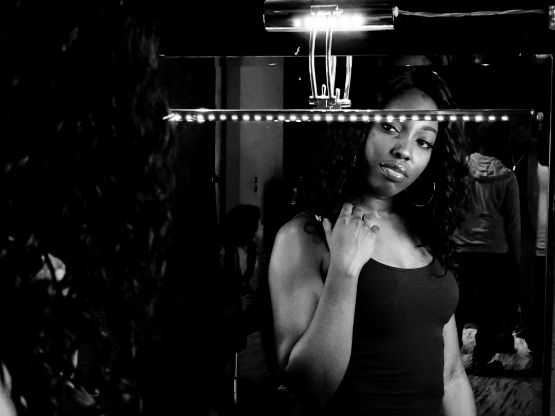 A woman looks at herself in the mirror as she prepares to star in a music video.