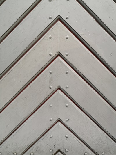 white wooden door with black steel door handle