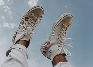 person wearing brown converse all star high top sneakers
