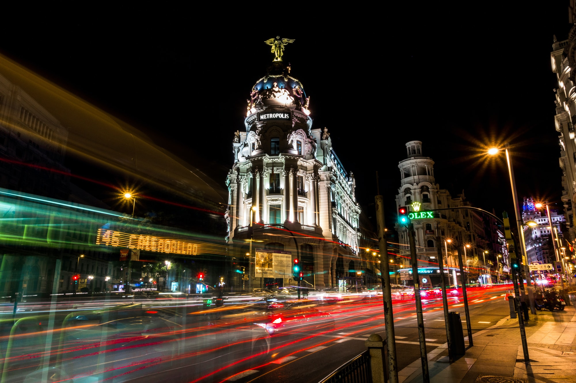 A bus driving by at night and a wonderful long-exposure capture in the beautiful city center of Madrid Spain. Please consider adding credit to the link in my bio :-).
