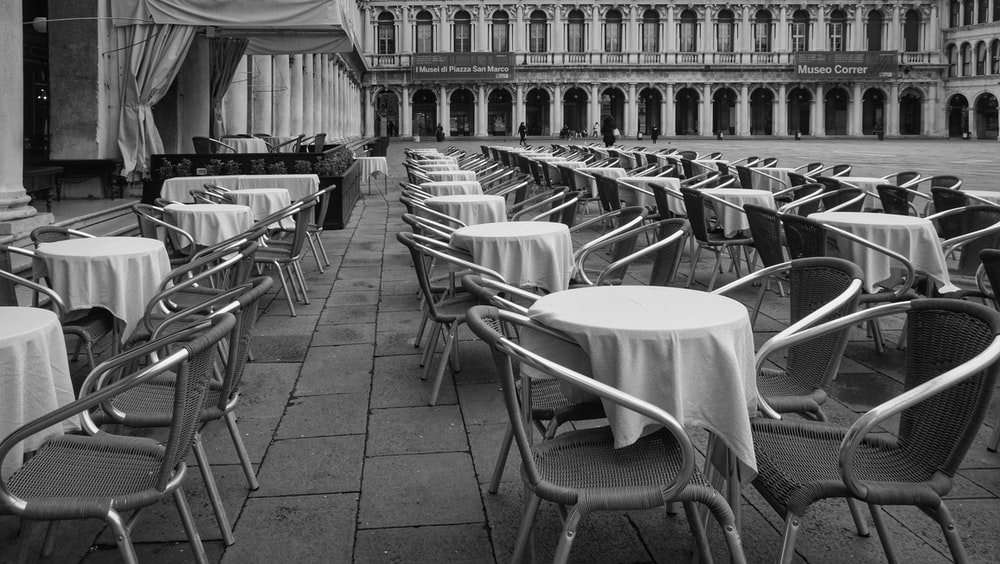 white chairs and tables in a restaurant
