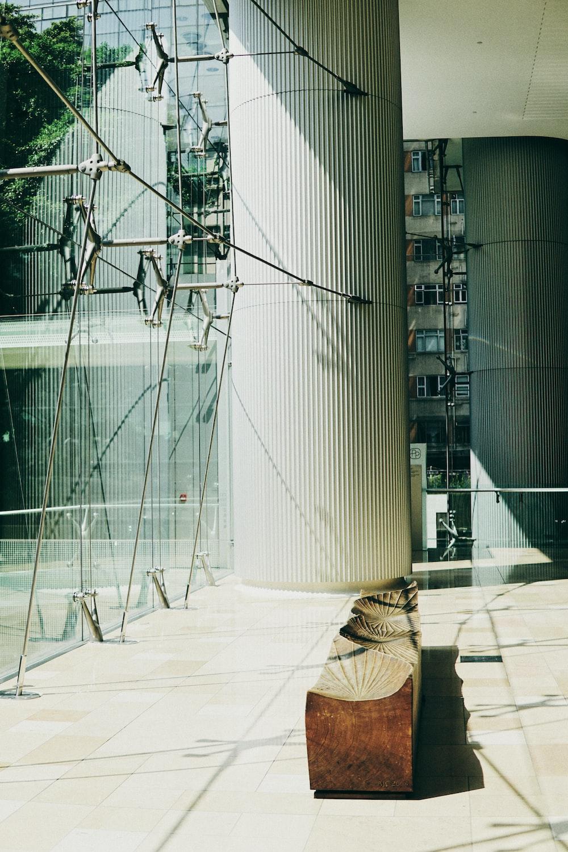 white metal frame near glass building