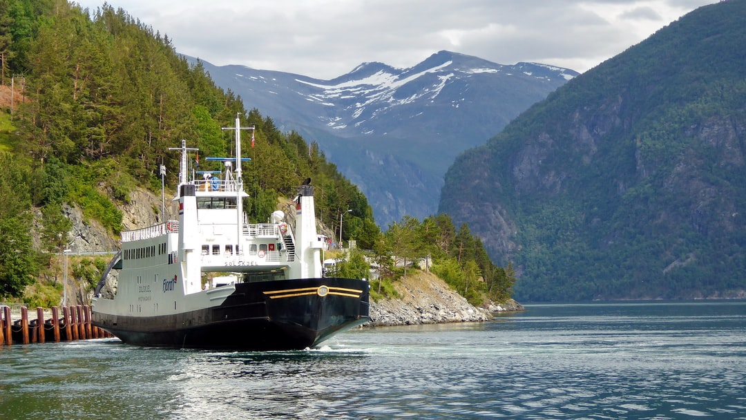 When traveling fjords of Norway even a simple car ferry ride becomes a pleasure. So much to see and explore; here the ferry between Eidsdal and Linge offers nice views into deeper parts of the fjord with mountain scenery.