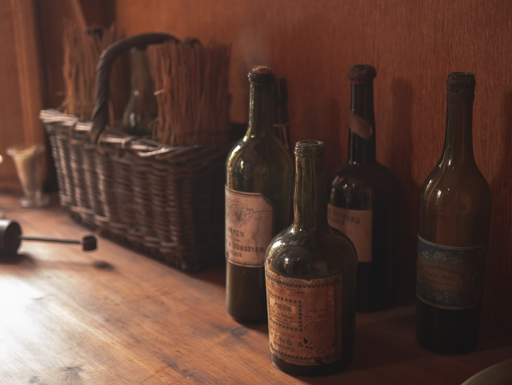 brown labeled bottle on brown wooden table