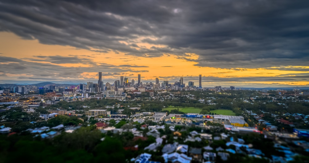 city skyline under cloudy sky during sunset