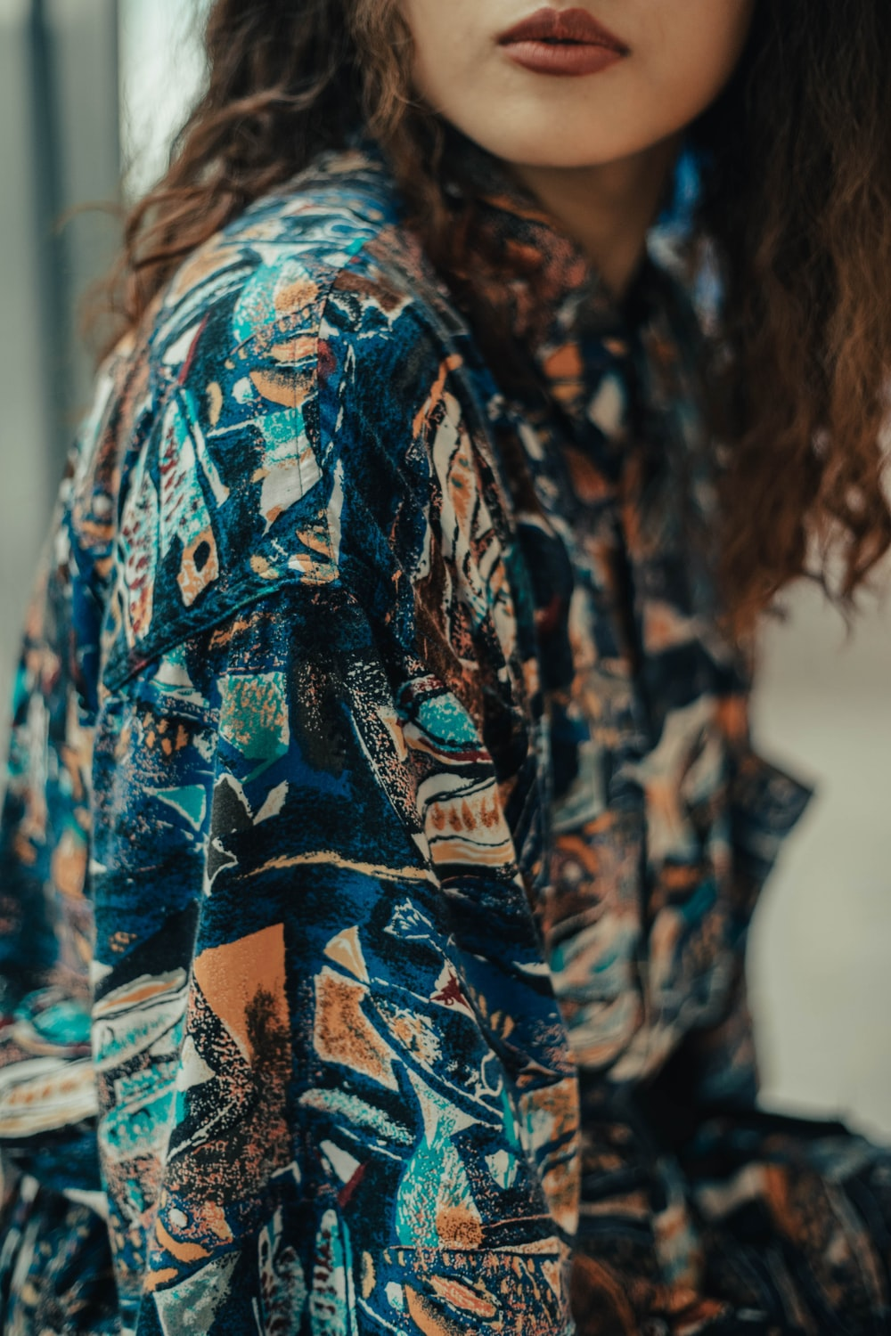 woman in blue and orange floral shirt