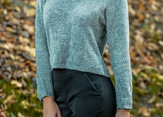 woman in gray sweater and black pants