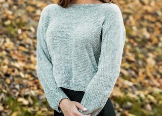 woman in gray long sleeve shirt and black pants