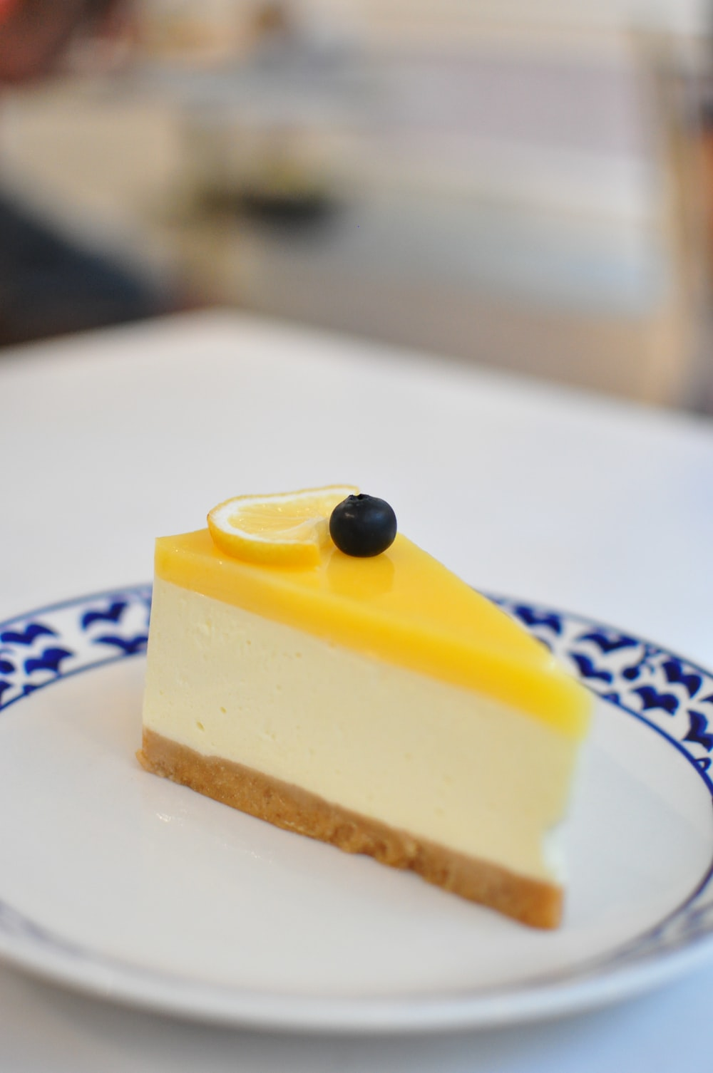 yellow cake on white and blue ceramic plate