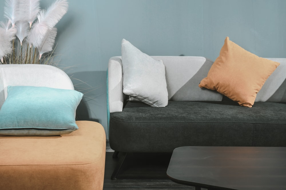 white throw pillow on black couch