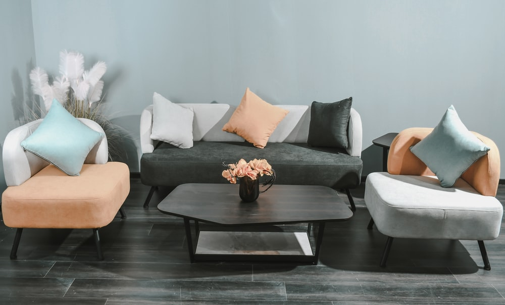 white throw pillows on gray couch