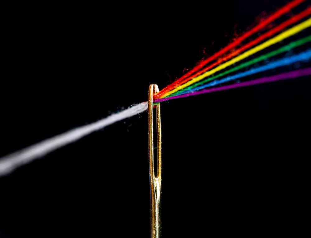 multi colored light streaks on white background