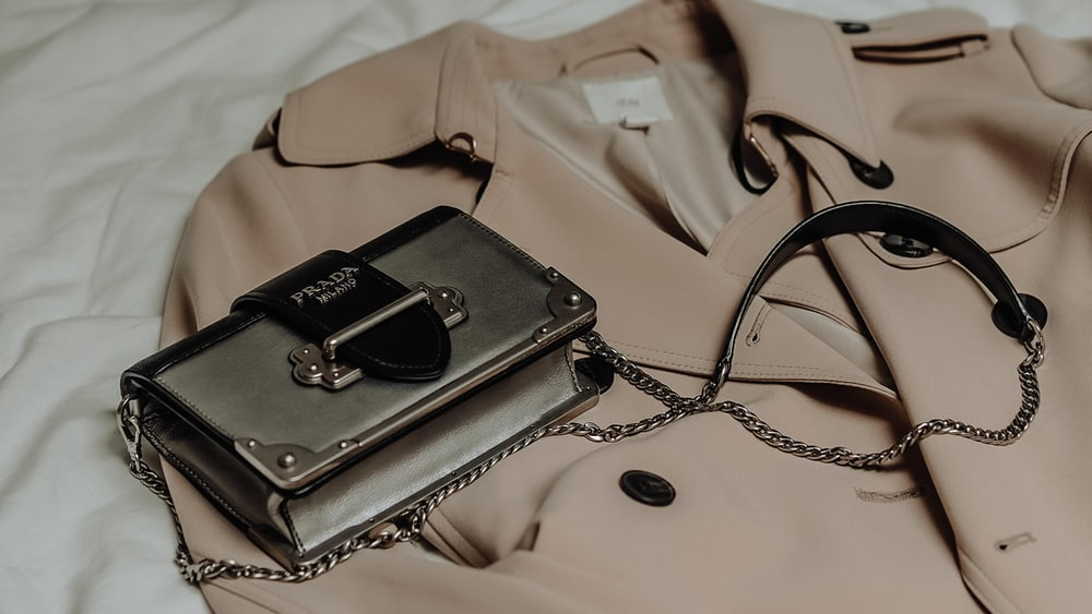 black and gray leather sling bag