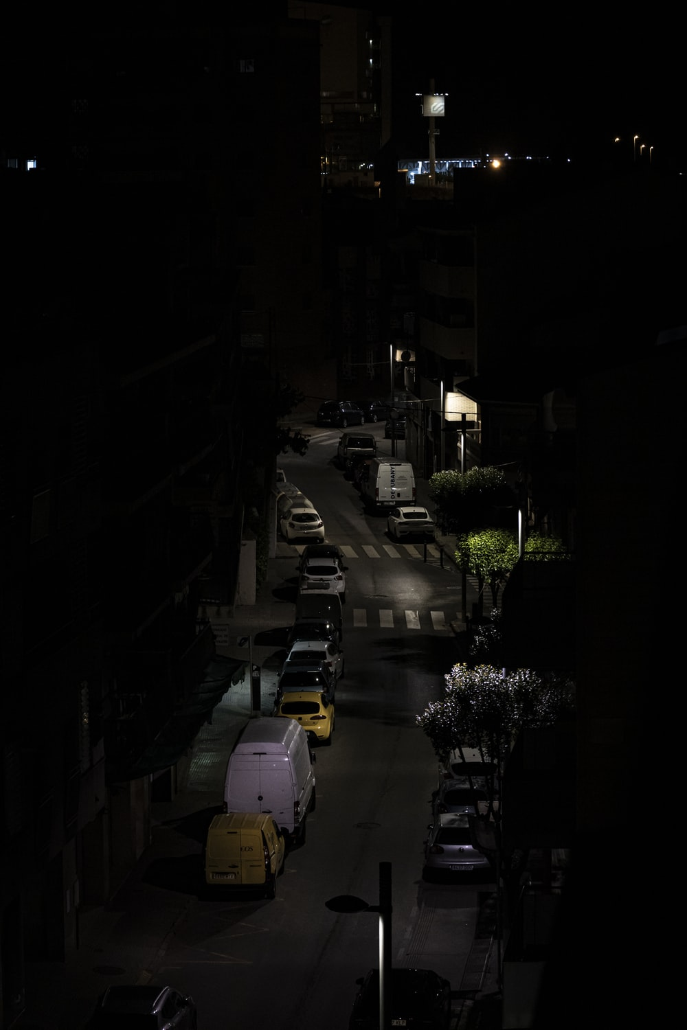 cars parked on the side of the road during night time
