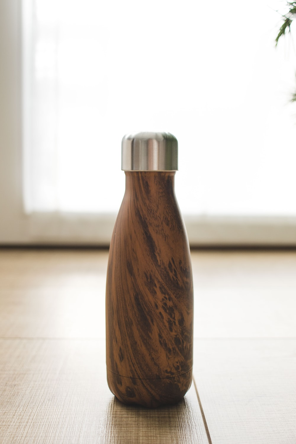 brown wooden bottle on white table
