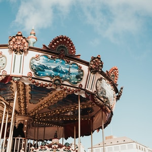 white and brown carousel under blue sky during daytime